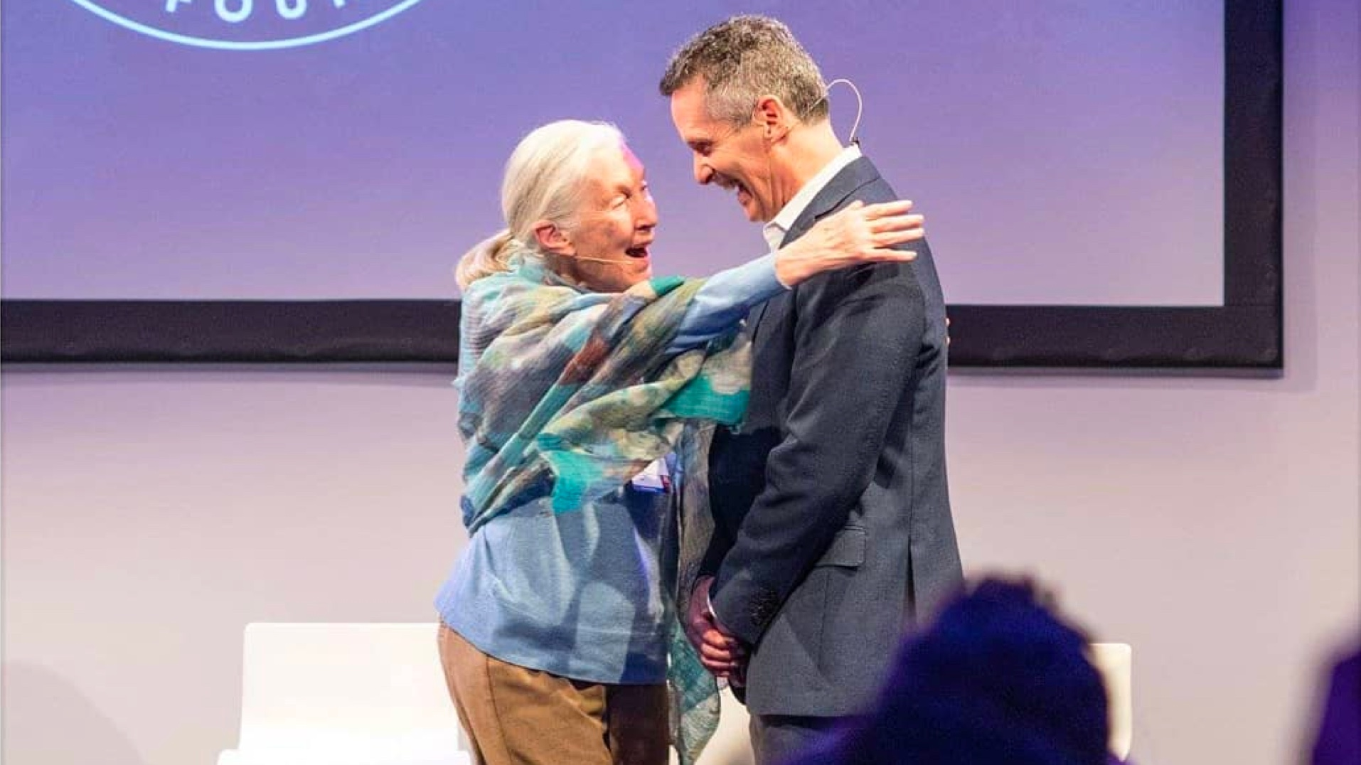 Jane Goodall embracing Dan Springer