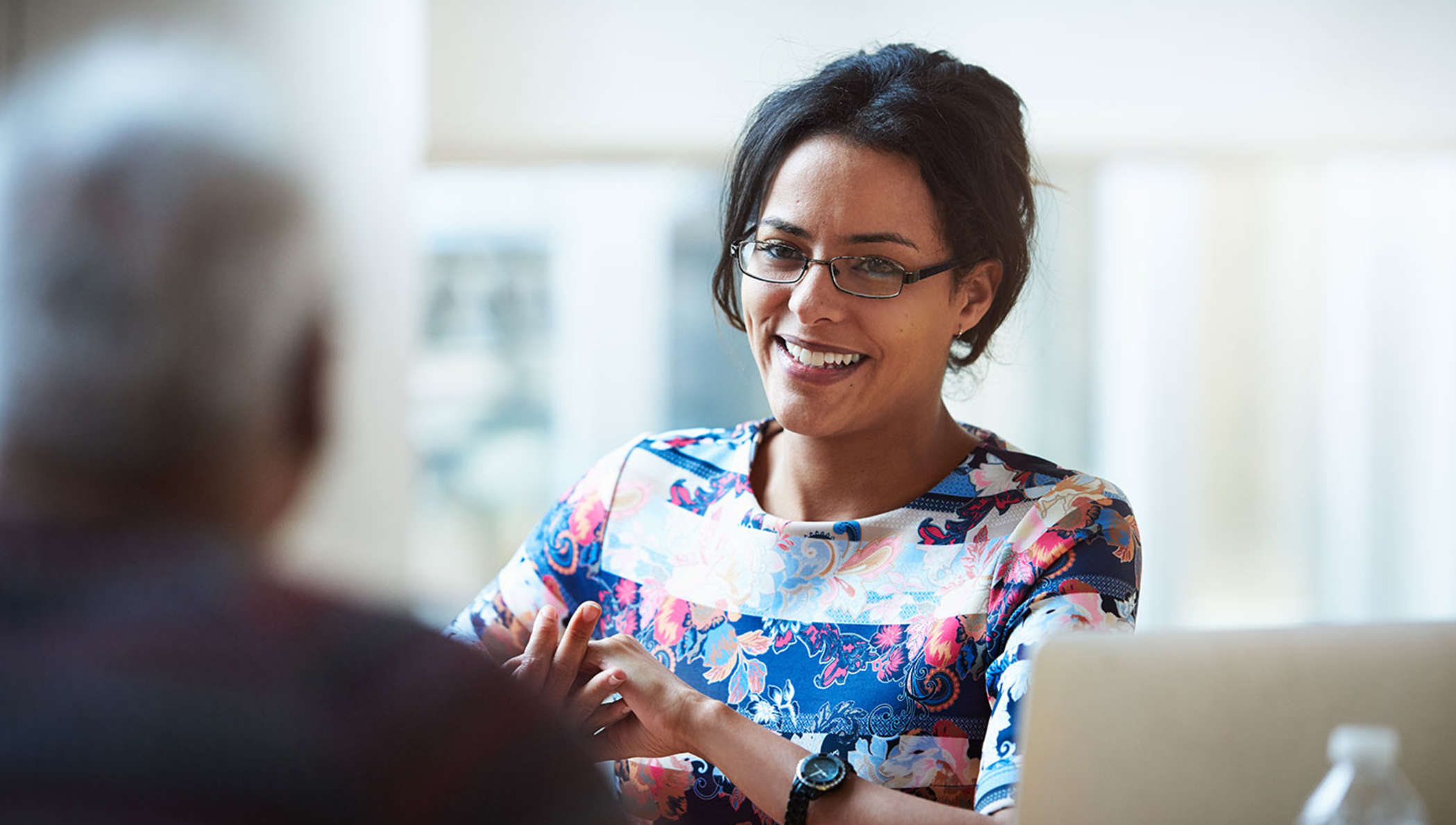 Nurse in a meeting with a patient to discuss DocuSign electronic signing options.